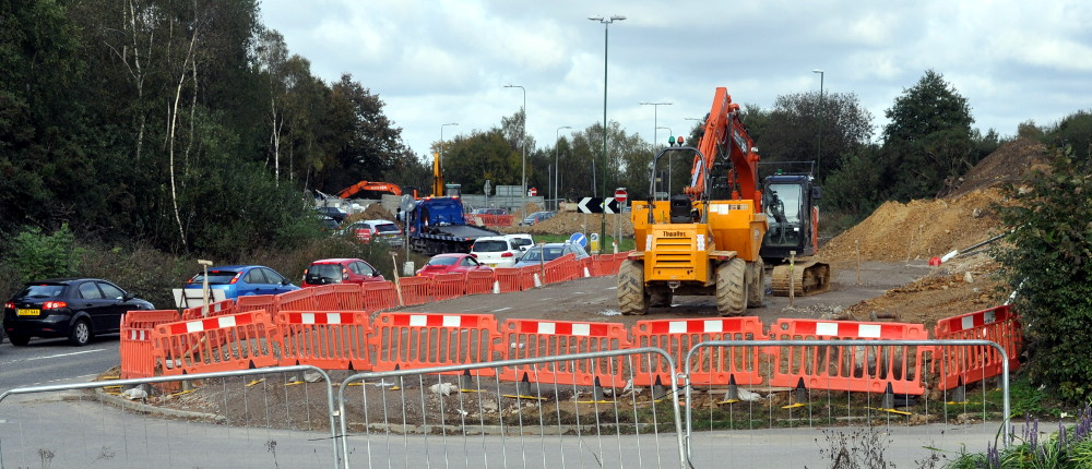 Excavating and traffic jam, Pease Pottage, 20 October 2019