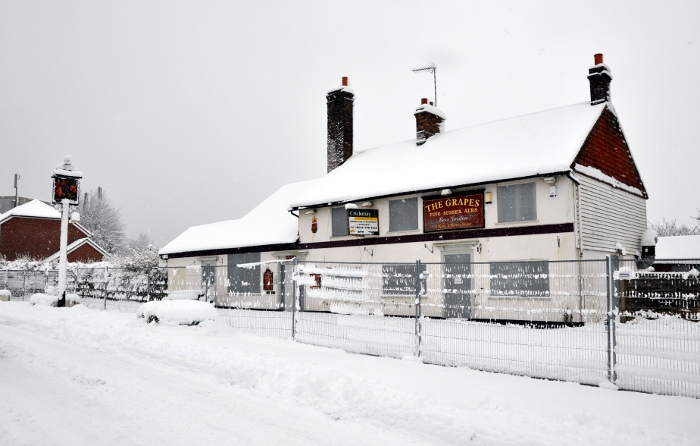 The abandoned Grapes pub, Pease Pottage, in winter